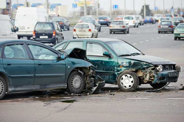 A side impact car accident with extensive damage to both vehicles