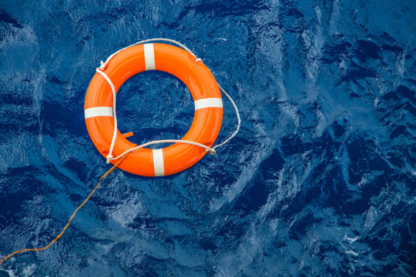 An orange life preserver in the water